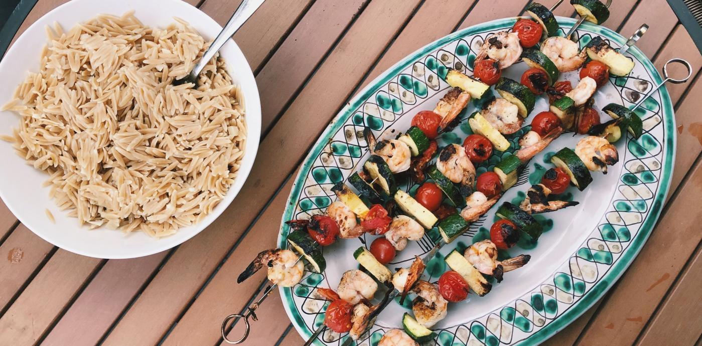 grilled shrimp and vegetable skewers served with whole grain orzo