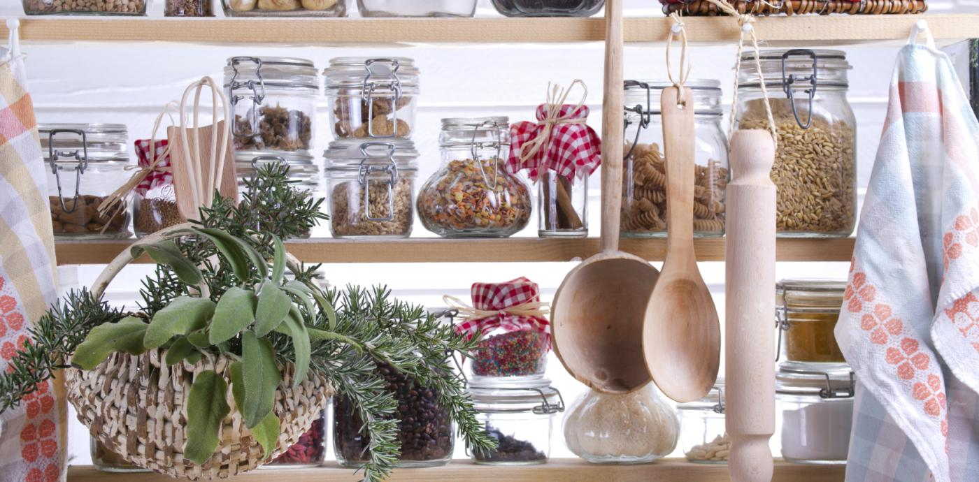 image shows pantry with jars full of dried grains and spices