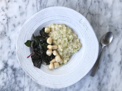 brown rice risotto topped with sauteed chard and small seared scallops