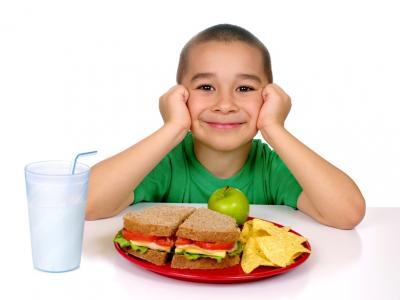 Child eating whole grain sandwich