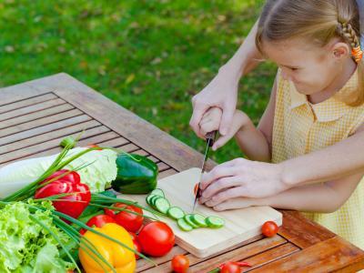 child chopping veggies