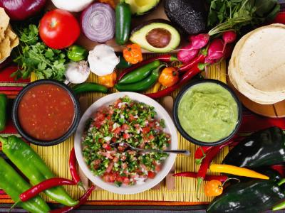 Spread with Latin American foods including salsa, guacamole and tortillas