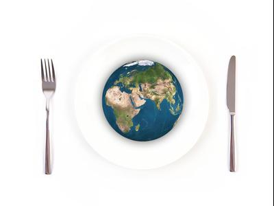 Picture of globe on a plate with a fork and knife