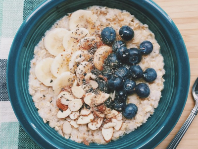Bowl of oatmeal with bananas and blueberries