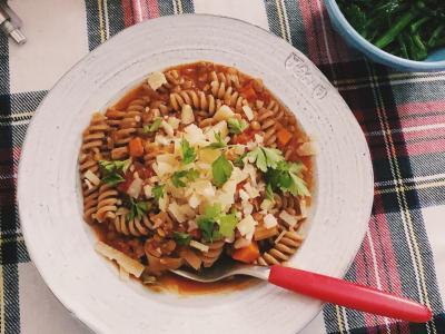 pasta bolognese on a plaid placemat