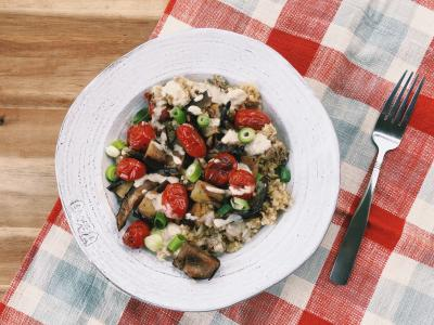 freekeh bowl with ground lamb, grilled tomatoes, and eggplant
