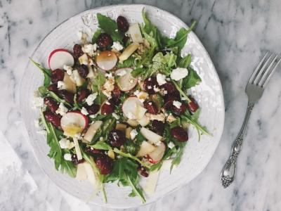 quinoa salad with cranberries, arugula, radishes, goat cheese, and kidney beans