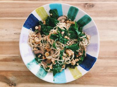 stir fried whole grain noodles with kale, mushrooms, and tempeh