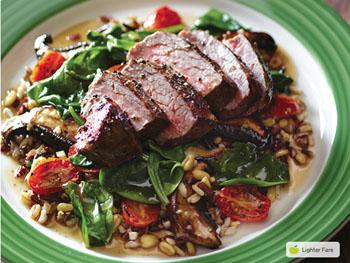 Applebee steak on a bed of whole grains