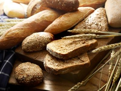 A table piled with loaves of different kinds of bread