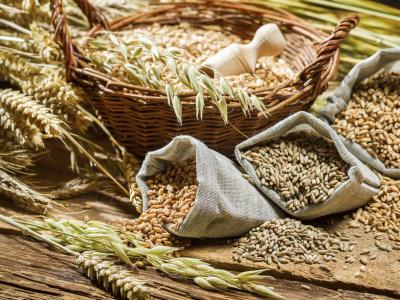 assorted whole grains in a basket and burlap bags