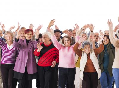 seniors with their arms raised