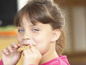 Girl eating whole grain cookie