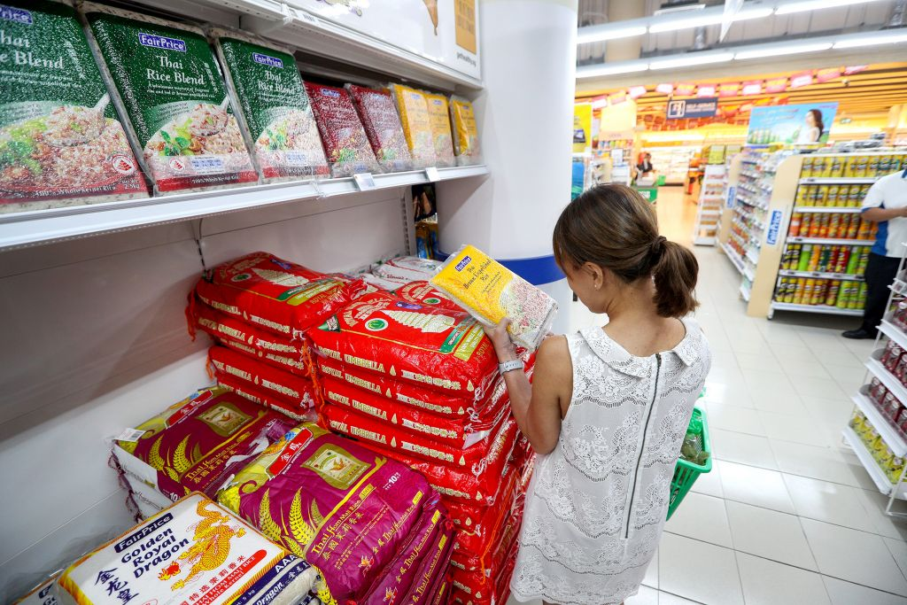 A Singaporean shopper buying brown rice