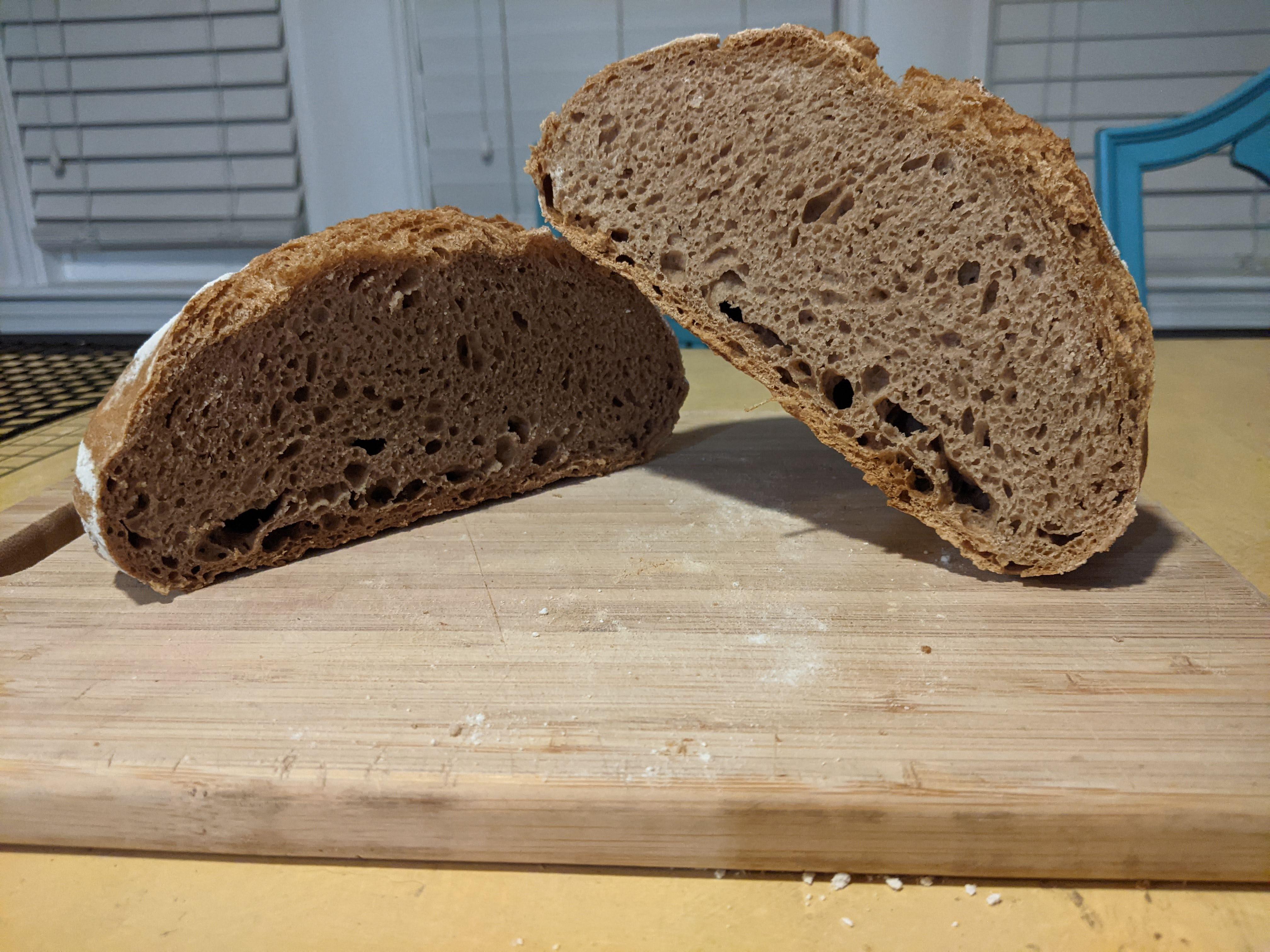 75% whole wheat loaf hut in half on cutting board