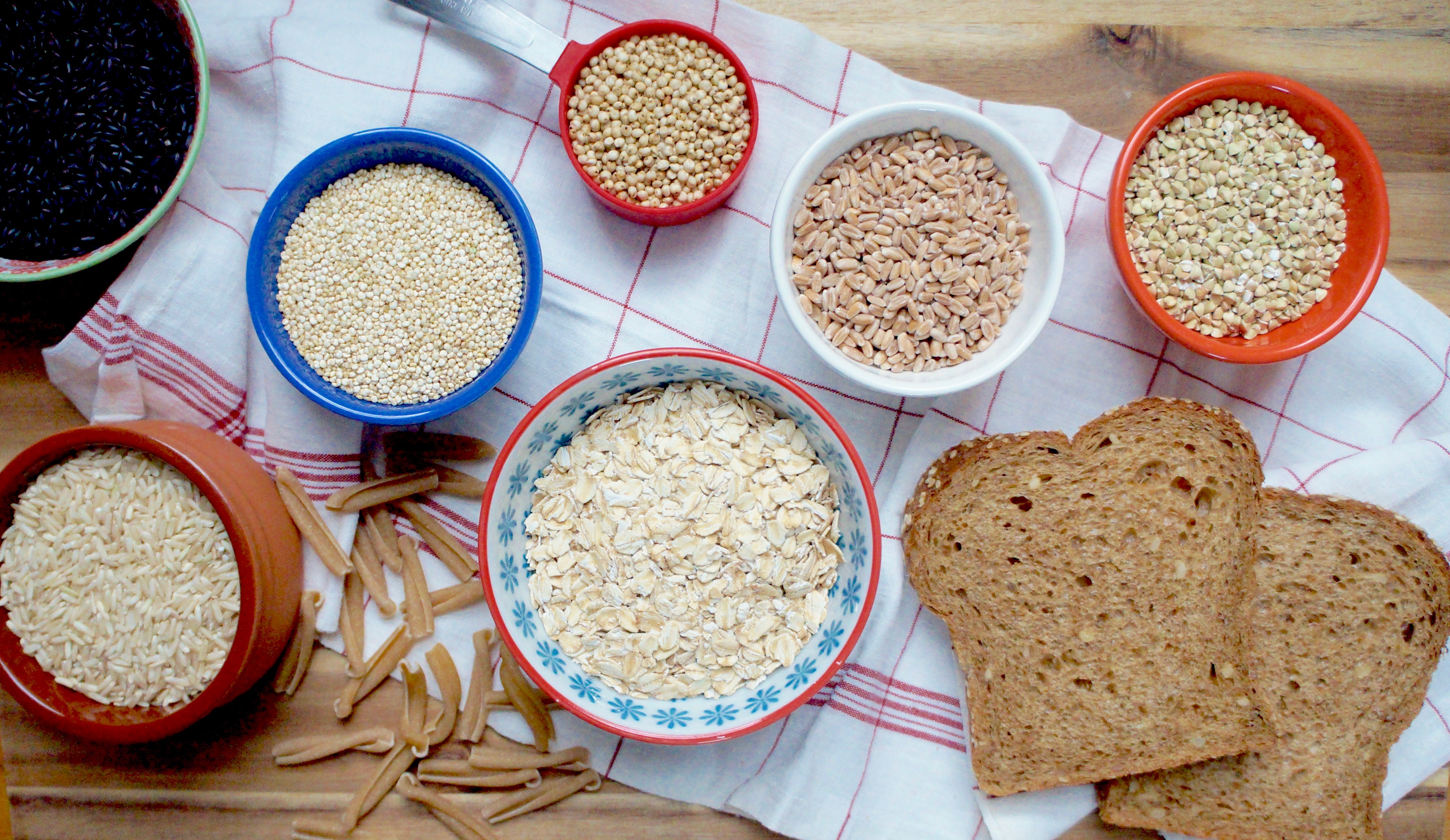 Assorted Grains in bowls and slices of bread