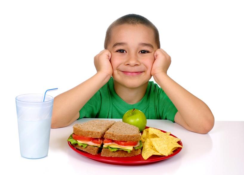 Child eating whole grain sandwich