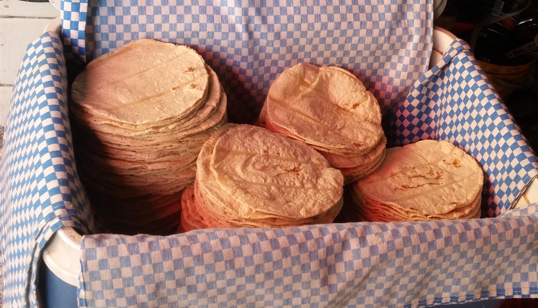 a box full of fresh tortillas