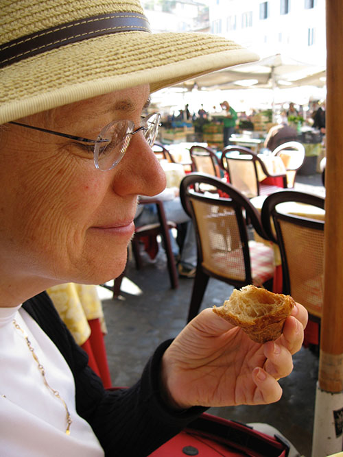 Cynthia Harriman eating a whole grain croissant in Rome
