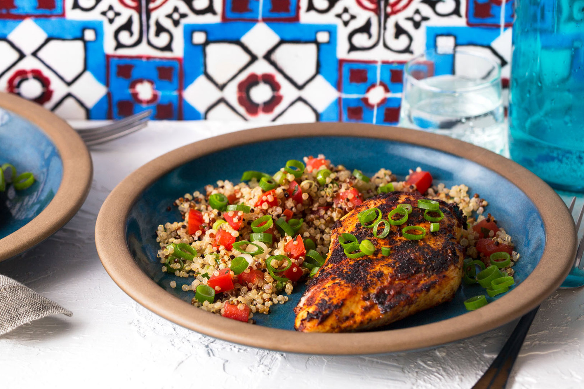 Lebanese-style chicken breasts with quinoa and tomato tabbouleh