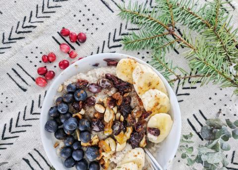 a bowl of fonio hot cereal with dried fruit