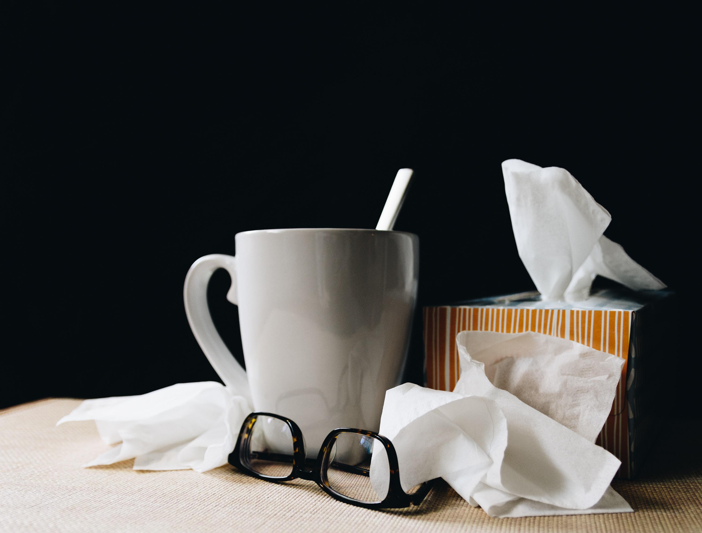 Mug with tea and tissue box