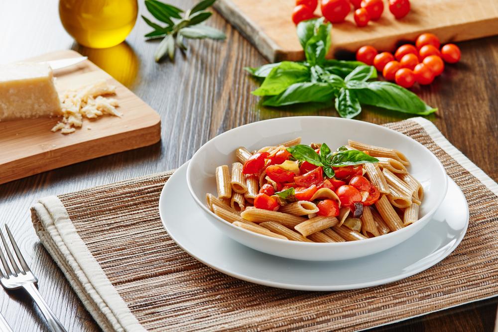 PastaMeal-WholeGrain-Penne-Tomatoes-shutterstock_313122035-pasta-tomato.jpg