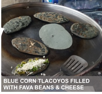 Tlacoyos cooking in a pan