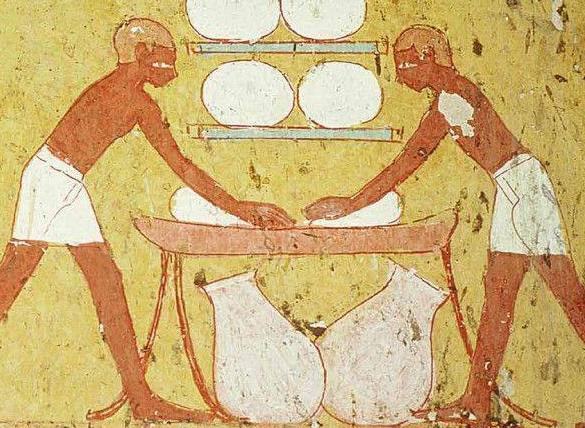 Ancient Egyptian workers knead bread