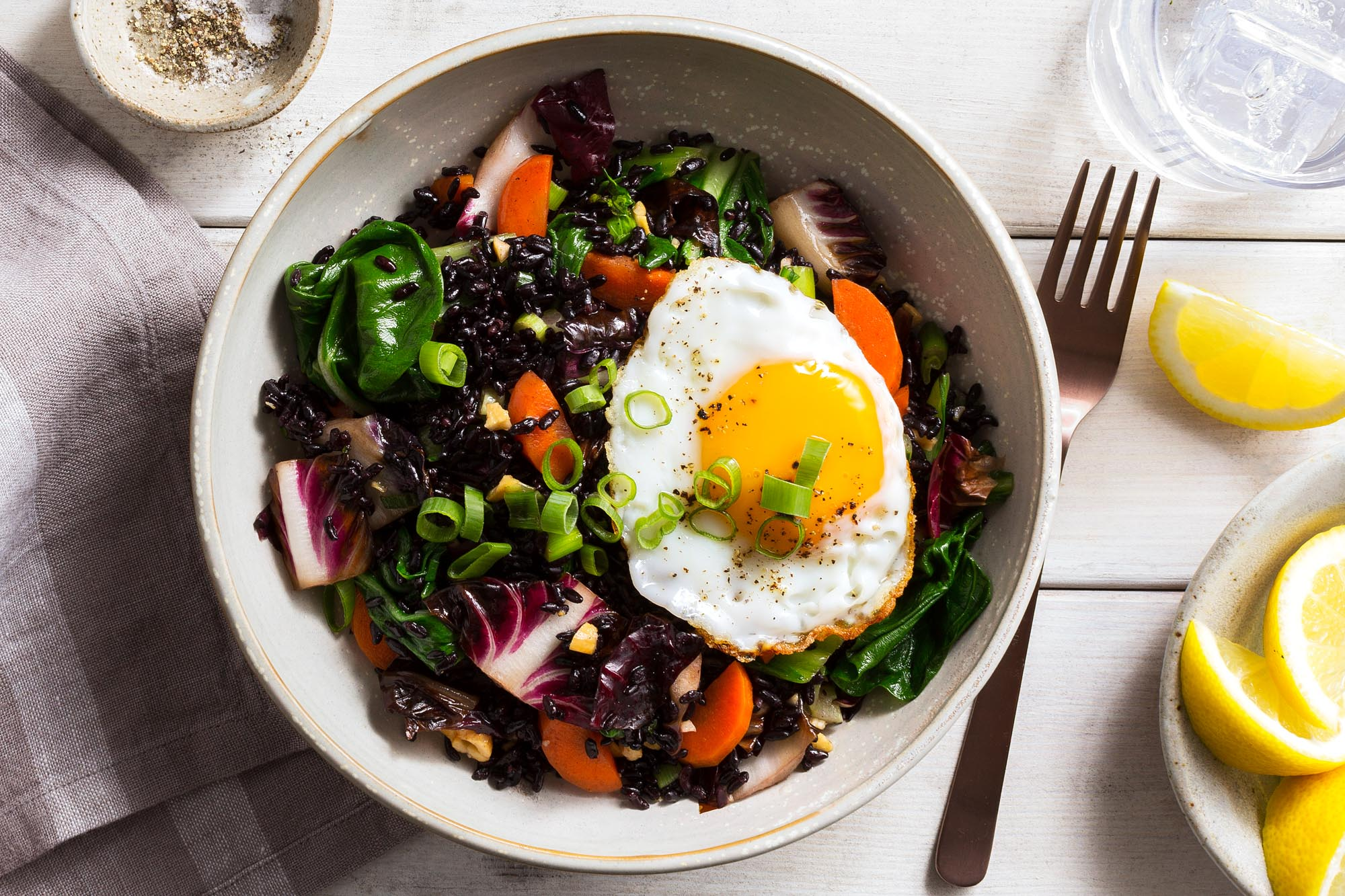 Thai stir-fry with bok choy, black rice, and fried eggs
