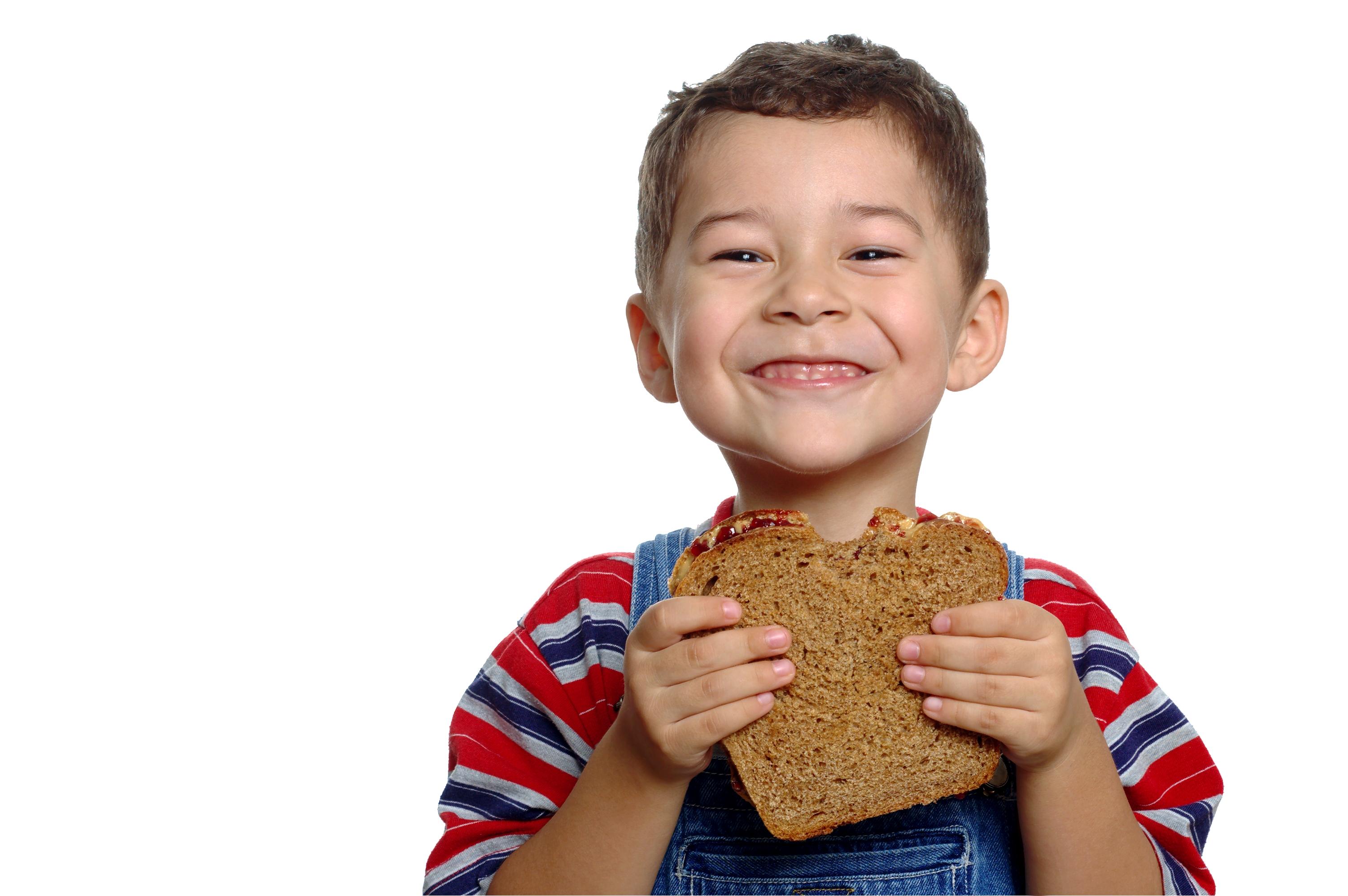 Child holding whole grain sandwich