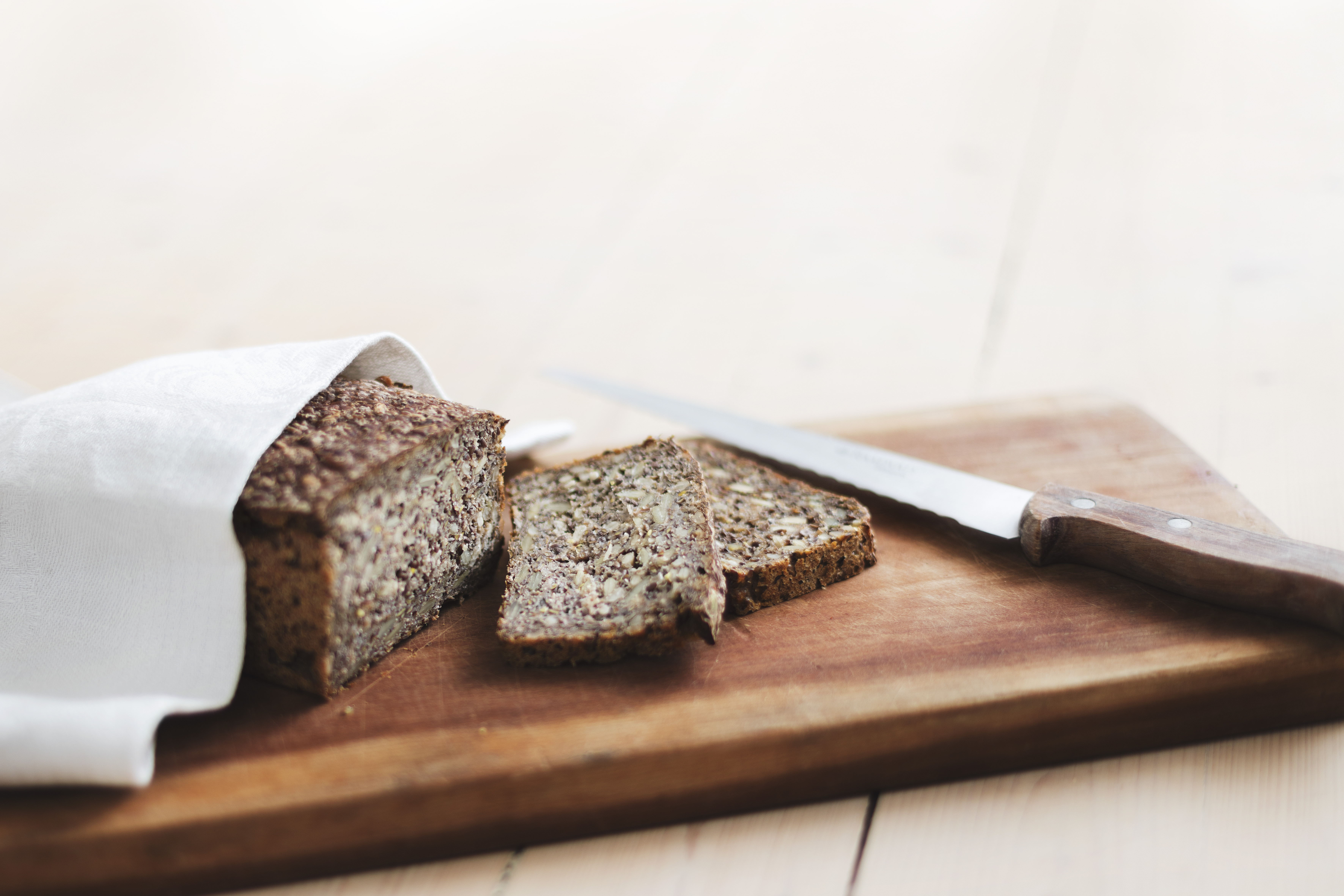 Cutting board and knife with slices of Finnish Rye Bread
