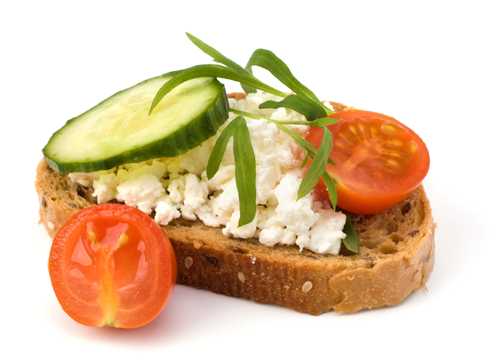 A slice of toast topped with ricotta and veggies