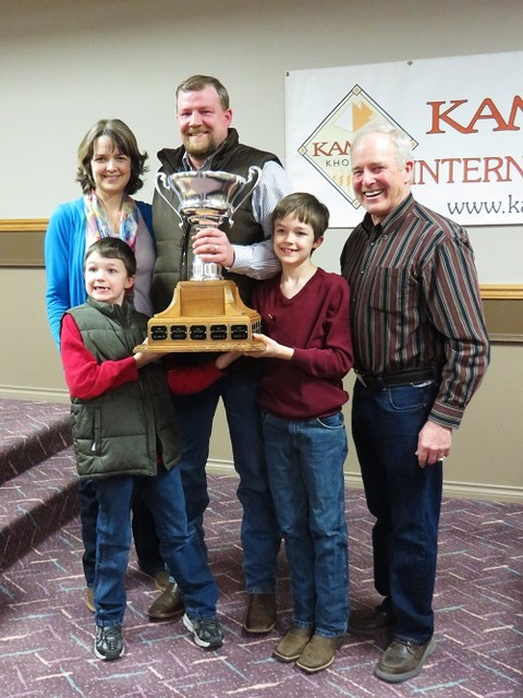 Photo of family with Kamut Cup trophy
