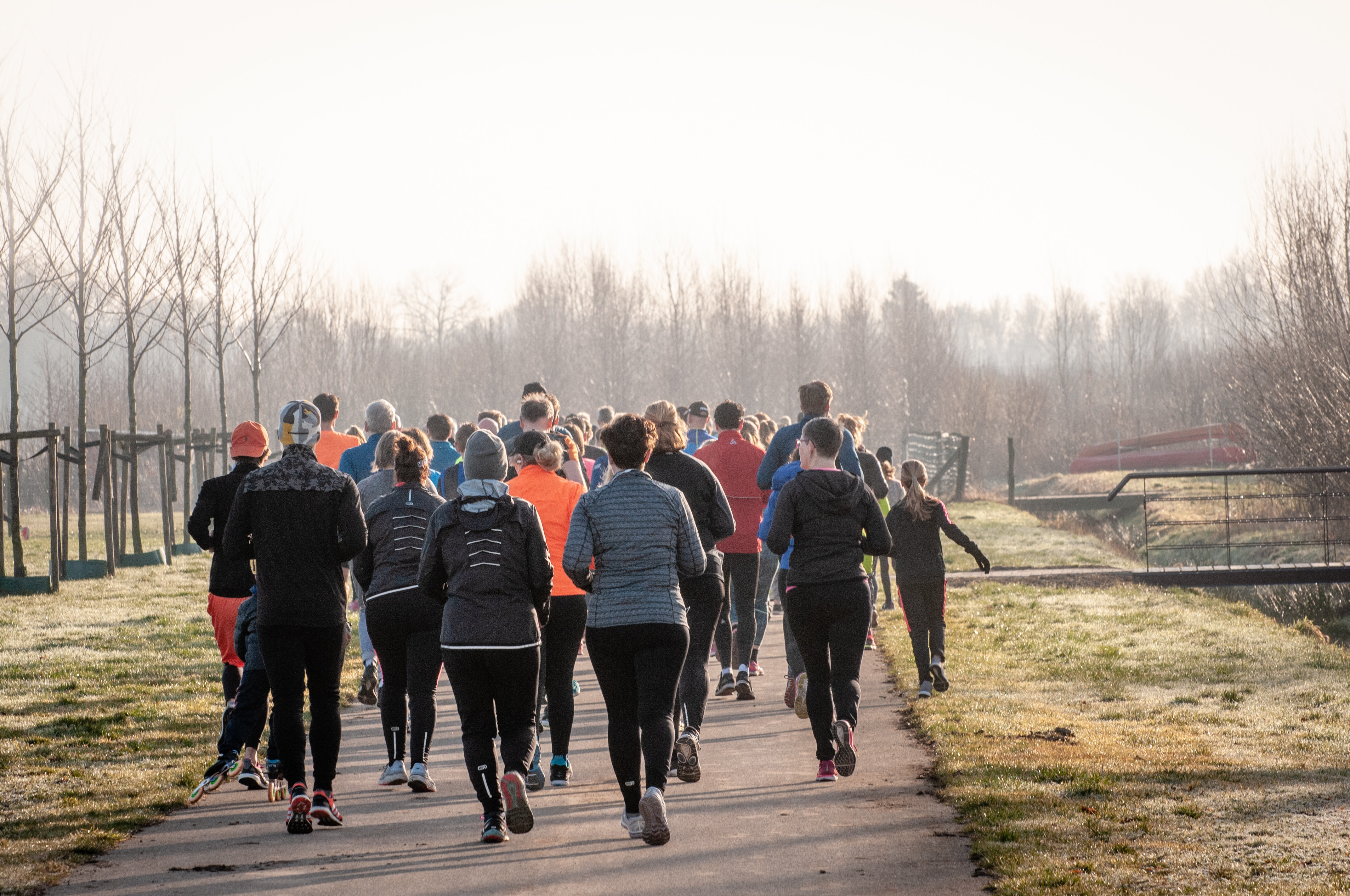 Group of people jogging in winter