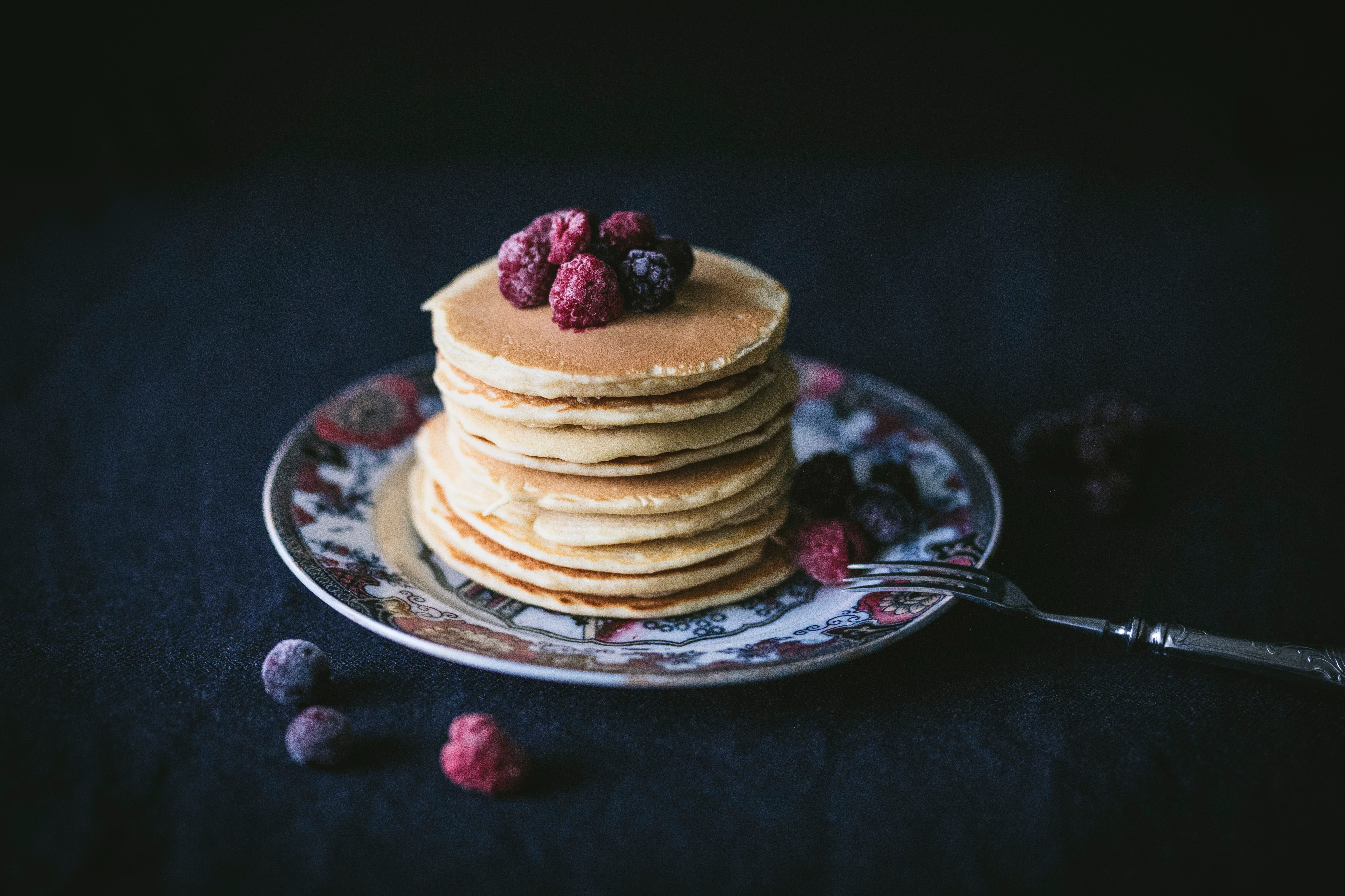 Stack of pancakes with fruit on top